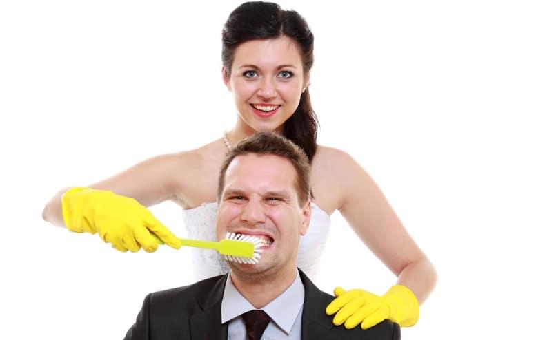 Emancipation idea. Woman brushing teeth of her man, humor